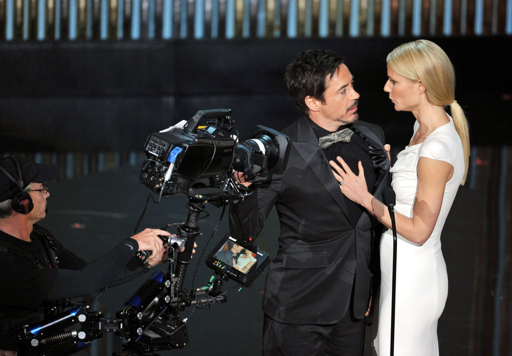 Gwyneth Paltrow and Robert Downey Jr. on stage at the Oscars.