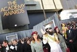 Sacha Baron Cohen Pranks Ryan Seacrest as the Dictator on the Oscars Red Carpet