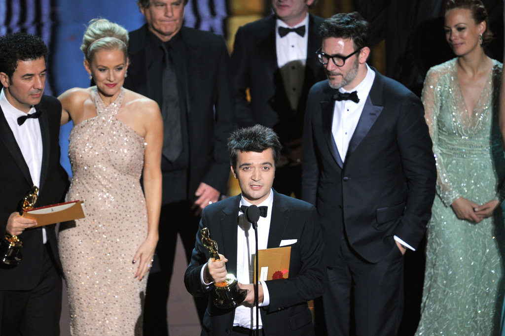 The cast of The Artist piled onstage to accept the best picture award at the 2012 Oscars.
