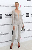 Karolina Kurkova went with something a little different — a sparkly jumpsuit by Armani. To offset the metallic sheen, she wore red velvet pumps, too.