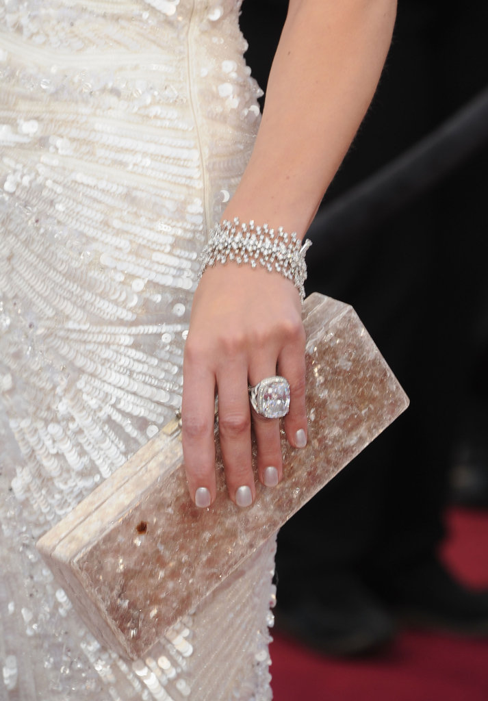 Milla Jovovich finished her sparkly Elie Saab with an embellished Edie Parker clutch in hand.