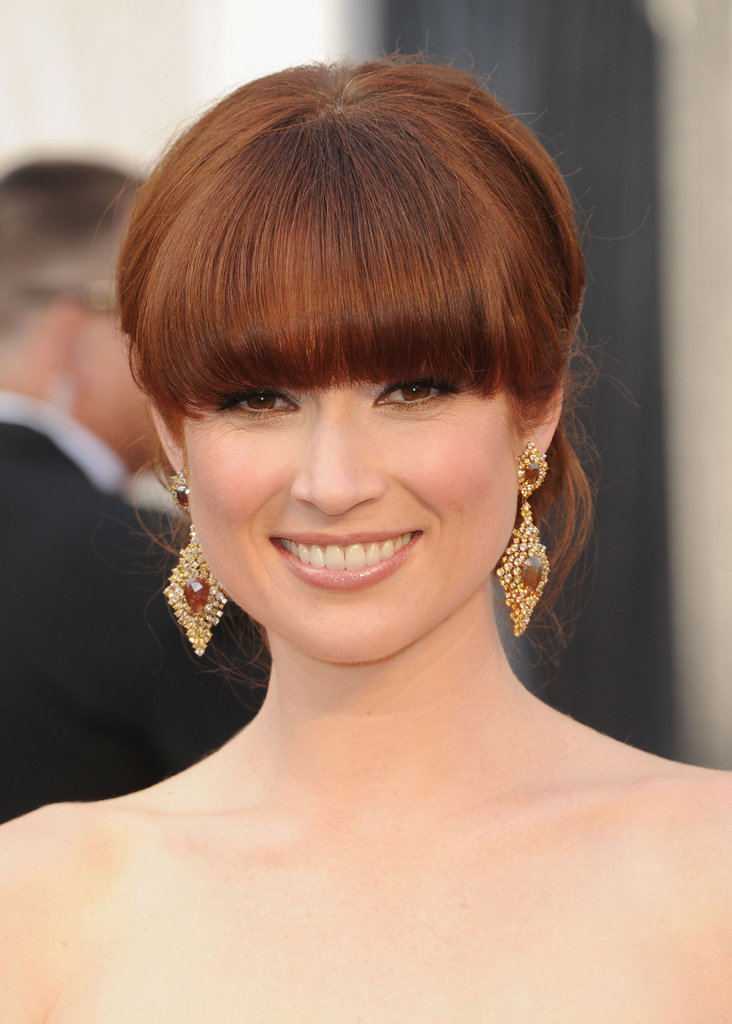 Ellie Kemper accessorized her Armani gown with statement-making earrings.