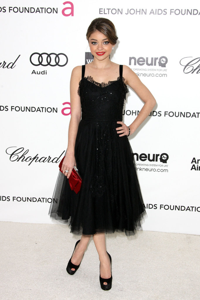 Sarah Hyland chose a ballerina-inspired black Collette Dinnigan dress, peep-toe pumps, and a red clutch for her appearance.