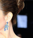 Tina Fey flashed a pair of sapphire chandelier earrings.