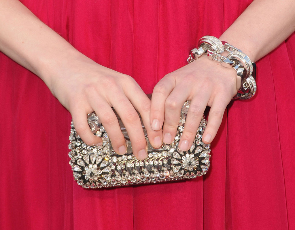 Emma Stone showed off an intricate Louis Vuitton clutch and chain-link bracelet.