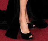 Angelina finished her gown with a pair of custom-made black velvet peep-toe platforms.