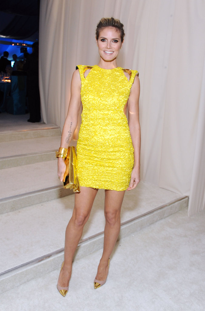 Heidi Klum opted for a bright pop of color with this neon yellow Versace minidress and shiny gold clutch.