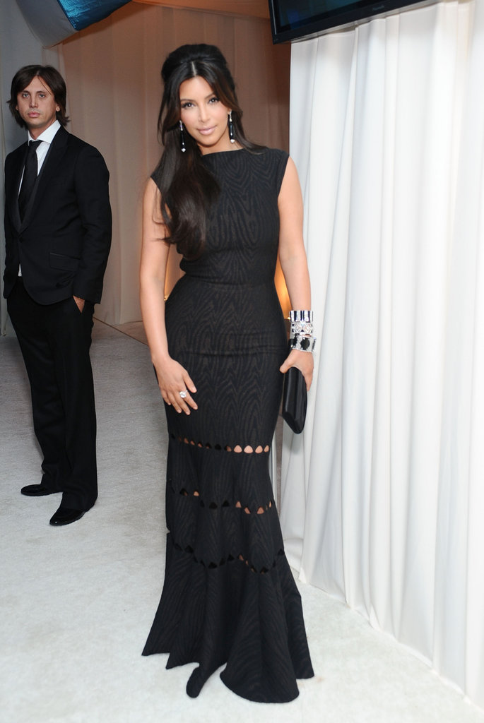Kim Kardashian stepped out in a form-fitting black gown by Alaia paired with Lorraine Schwartz jewels and Christian Louboutin heels.