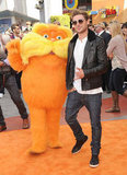 Zac Efron was looking cool as he strut down the carpet with the Lorax.
