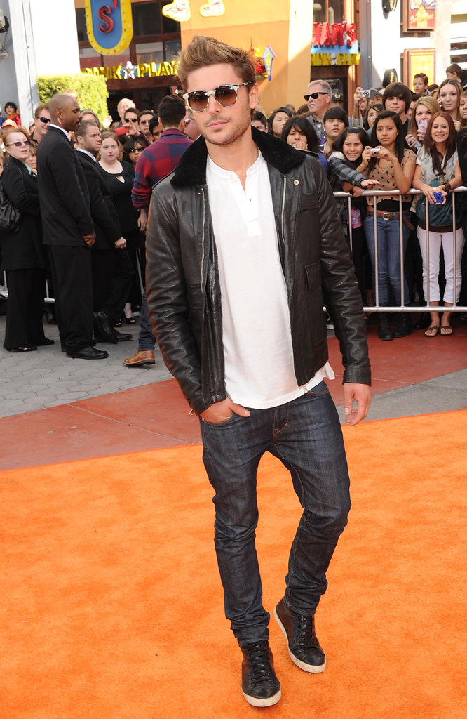 Zac Efron walked down the carpet as fans took pictures.