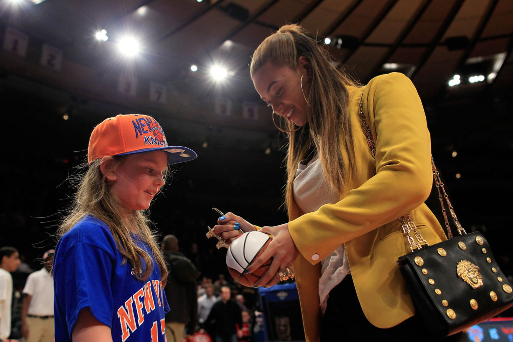Beyoncé signed a basketball for a fan.