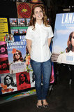 While at Amoeba Music in Hollywood, the singer sported a classic look via a short-sleeve white button-down with skinny jeans and flats.        Button Front Tops by DickiesFlats by Salvatore Ferragamo
