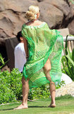 Kelly Ripa's green tunic was hard to miss on the beach.
