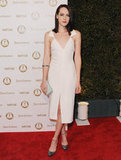 Jena Malone wore a modern white front-slitted dress — we love the shoulder strap detail.