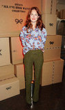 Taylor Tomasi Hill wore a bright floral print blouse with chartreuse-colored trousers backstage at Anya Hindmarch.