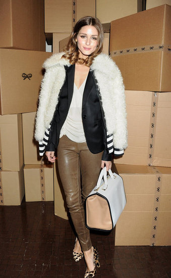 With a furry topper and slick leather bottoms, Olivia styled up an effortless front-row look for Anya Hindmarch. 4762026