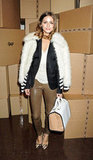 Olivia Palermo layered up her leather pants and blazer look with a cool fur varsity jacket at Anya Hindmarch.