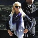 Reese Witherspoon wearing a tie-dyed scarf.