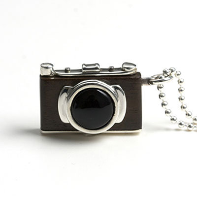 Sterling silver and hardwood SLR camera necklace ($539) on a 30-inch-long chain