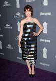 Ellie Kemper opted for a metallic striped strapless.