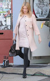 While filming a scene from A Case of You, Sienna paired a nude-colored nonmaternity DVF lace dress with a pale-pink coat and jet-black tights for a perfectly sweet look.