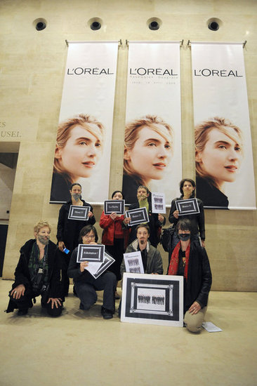 "Women from the feminist group ""La Barbe"" (The Beard) protest against L'Oréal for not having enough women in management positions."