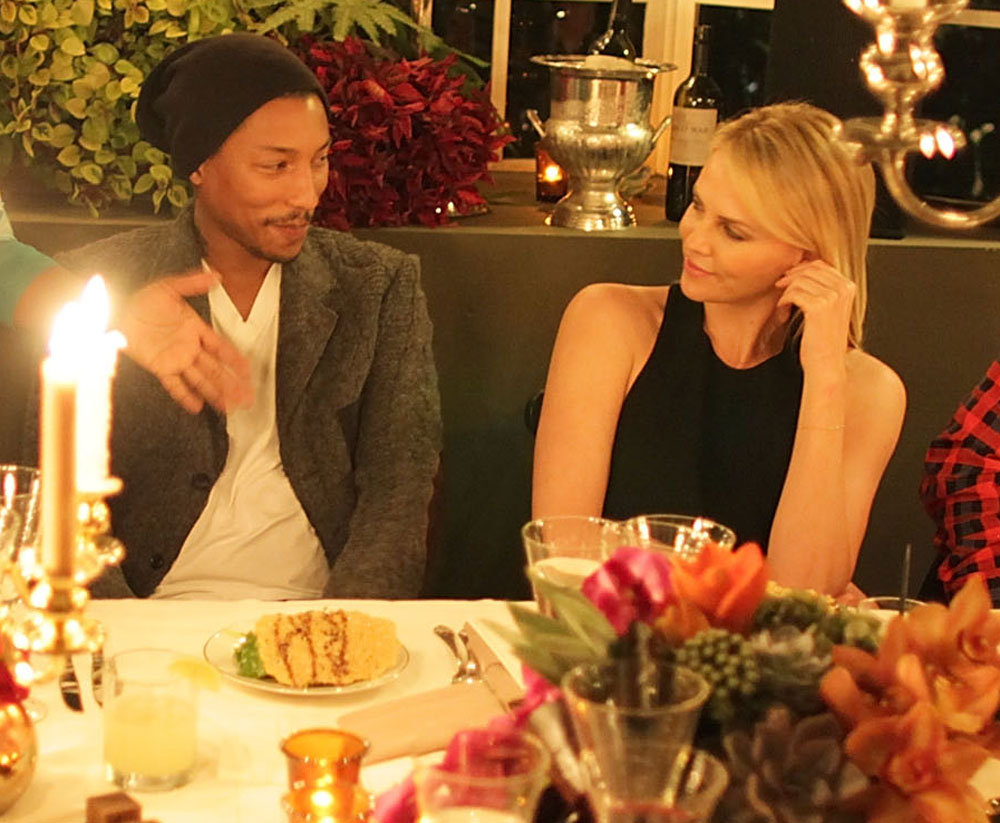 Charlize Theron shared a sweet look with Pharrell Williams.