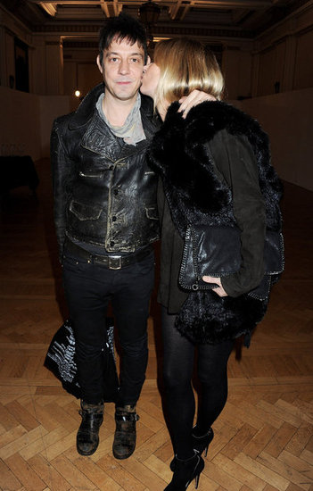 Kate Moss planted a kiss on husband Jamie Hince as the couple checked out a fashion show in London in February 2012.
