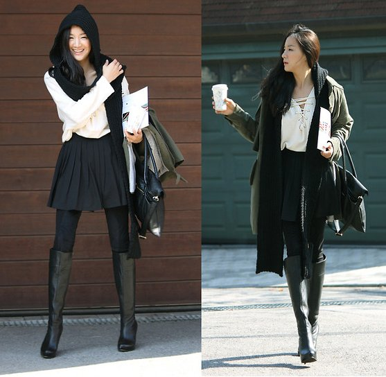 An anorak and knee-high boots are just the things you need to style up a soft white blouse and pretty pleats for the change of seasons.  4775794 Photo courtesy of Lookbook.nu