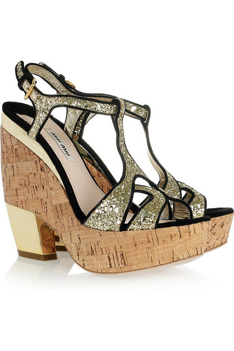 The glitter detailing and gold heel add a glamorous touch to these cool cork wedge sandals.  Miu Miu Glitter Wedge Sandal ($750)