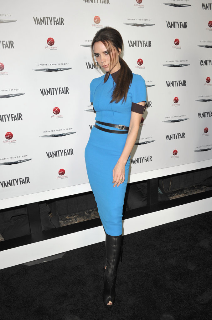 Victoria Beckham wore a blue sheath dress with leather embellishments from her own line at the Vanity Fair and Chrysler cohosted bash in LA. Check out Victoria Beckham's latest Fall 2012 collection right here.