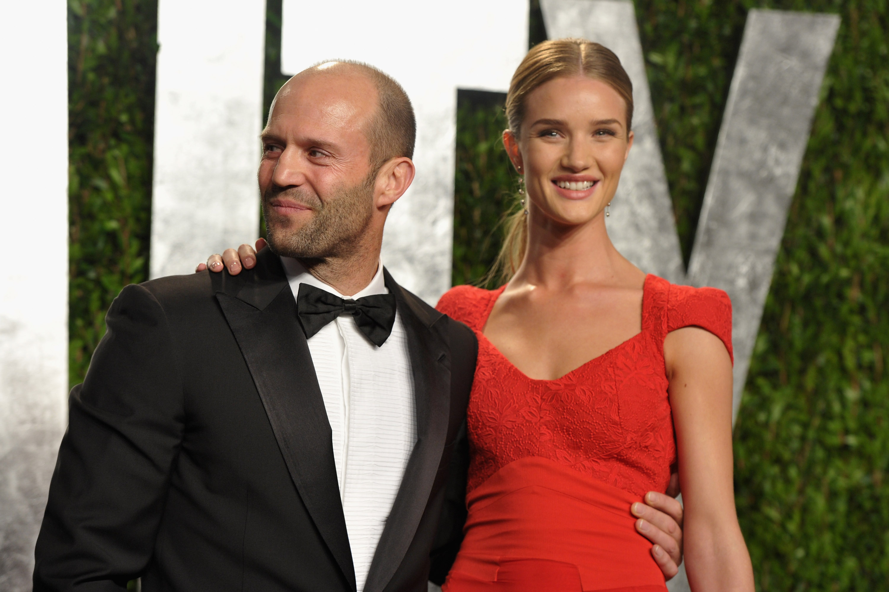 Jason Statham and girlfriend Rosie Huntington-Whiteley at the Vanity Fair afterparty.