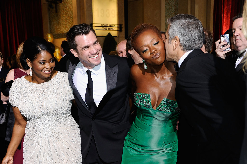 The Help's Octavia Spencer, director Tate Taylor, and Viola Davis said hello to George Clooney.