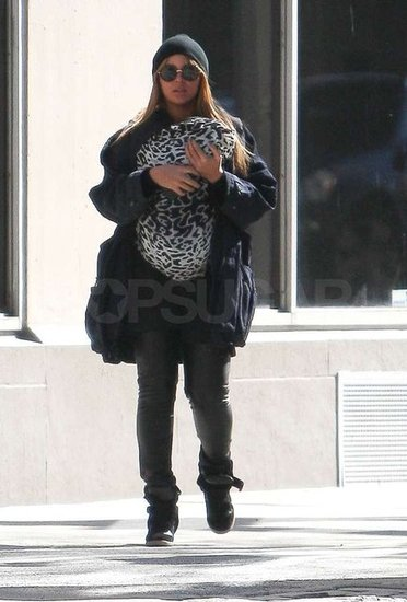 Blue Ivy Carter was wrapped up in animal print as mom Beyoncé Knowles carried her.