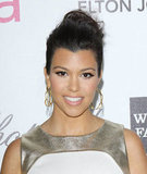 Kourtney Kardashian's gold hoops make double the statement, thanks to intricate crisscross detailing.  4801754