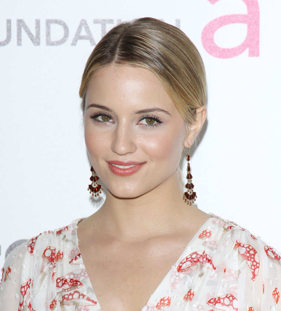 Dianna Agron swept back her hair to reveal tiered jeweled earrings.