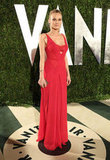 Diane Kruger's red Calvin Klein collection stunner gets an extra dose of sexy from a plunging neckline, lacy bralette, and subtle sheer insets at the sides.