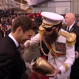 Sacha Baron Cohen as The Dictator Spilling Ashes on Ryan Seacrest at 2012 Oscars Video
