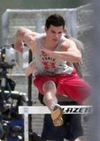 Taylor Lautner lept over hurdles while filming Valentine's Day in LA in 2009.