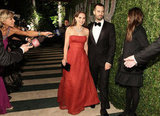 Natalie Portman and Benjamin Millepied were hand in hand on their way into the 2012 Vanity Fair Oscars party.