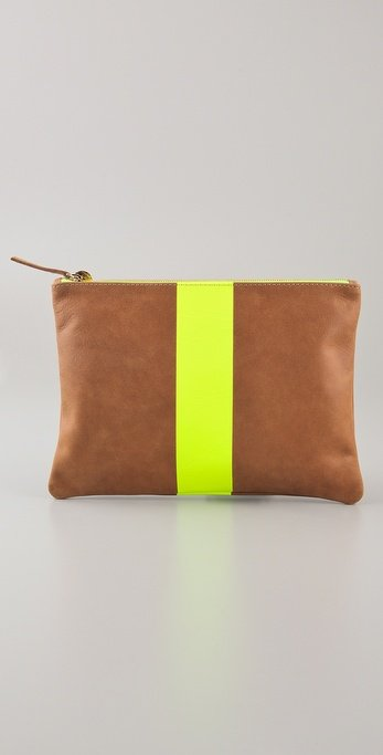 We love the flash of neon color to update a basic clutch for Spring.  Clare Vivier Neon Stripe Flat Clutch ($158)