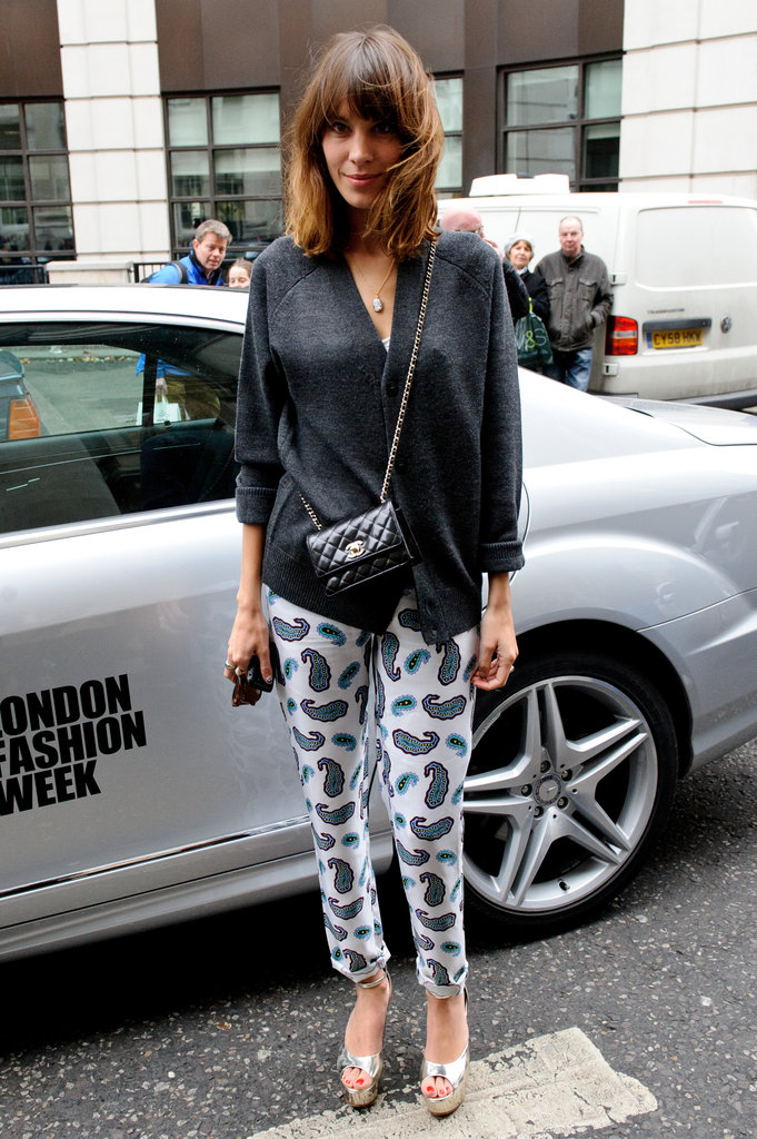Alexa Chung dressed up her printed pants with silver-toned platforms.