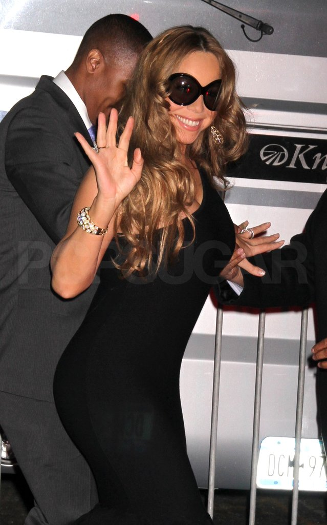 Mariah Carey waved in a tight black dress.