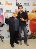 Zac Efron and Danny DeVito got playful with yellow mustaches.