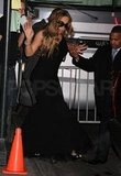 Mariah Carey wore a tight black dress.