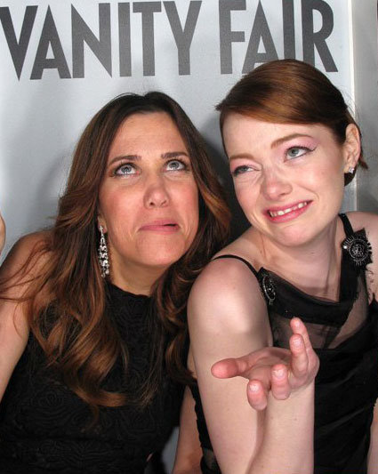 Emma Stone and Kristen Wiig took silly photo booth pictures at the Vanity Fair Oscars after party in March 2012.