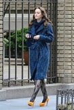 Leighton Meester in a blue coat and Brian Atwood pumps on the set of Gossip Girl in NYC.