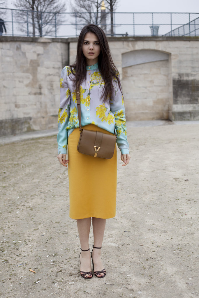 Paired with a mustard-yellow pencil skirt, this pastel floral-printed blouse is equal parts chic and whimsical.