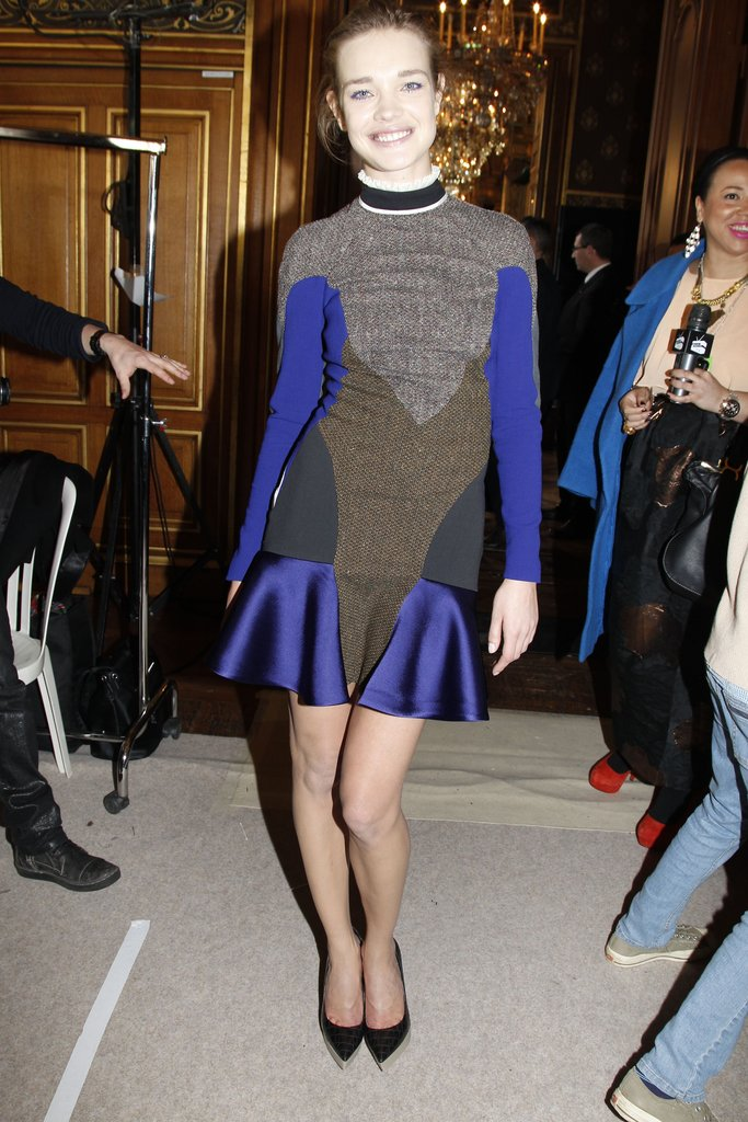 Natalia Vodianova hung out before the show, sporting one of Stella McCartney's more athletic drop-waist dresses.