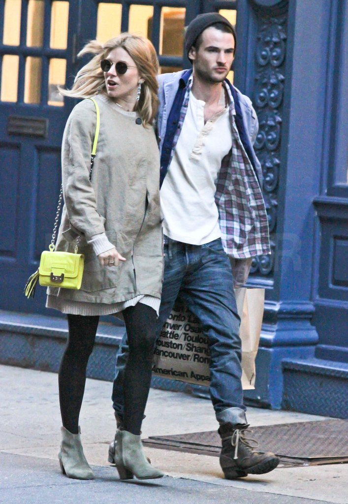 Sienna Miller and her boyfriend walking in NYC.